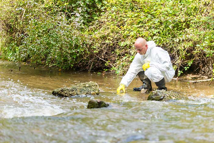 Gathering water for samples - Waste Profiling Services